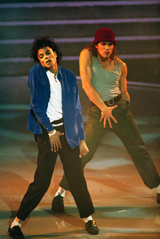 """. Michael Jackson, left, and unidentified dancer perform during Wednesday, March 2, 1988 Grammy Awards ceremony at New York\'s Radio City Music Hall. Jackson, whose album \""""Thriller\"""" won eight Grammy in 1984, saw his follow-up LP, \""""Bad,\"""" win only one this time around, for best-produced non-classical recording. (AP Photo/Ron Frehm)"""