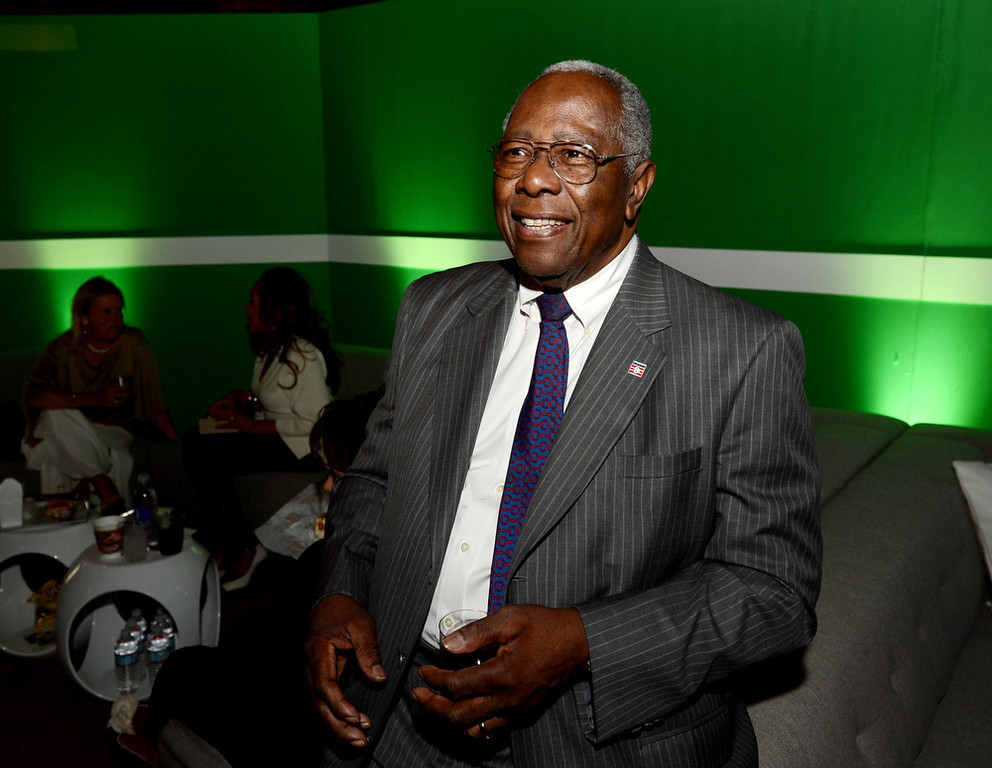 """. Former Major League Baseball player Hank Aaron poses at the after party for the premiere of Warner Bros. Pictures\' and Legendary Pictures\' \""""42\"""" at the Chinese Theatre on April 9, 2013 in Los Angeles, California.  (Photo by Kevin Winter/Getty Images)"""