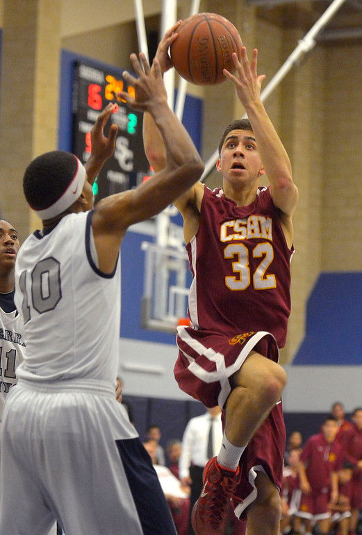 . Sierra Canyon\'s Juwan Trotter defends Cantwell-Sacred Heart\'s Andrew Martinez during their Division IV state regional semifinal game in Chatsworth, CA March 18, 2014.(Andy Holzman/Los Angeles Daily News)