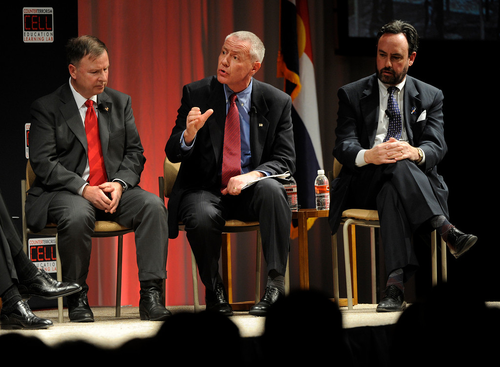 . DENVER, CO. - FEBRUARY 19:  Weld County District Attorney Ken Buck, center, shared his thoughts on crime statistics, saying that strong enforcement of laws has reduced crime. A panel moderated by Colorado Governor John Hickenlooper debated gun violence and gun  control legislation Tuesday night, February 19, 2013.  The event was sponsored by The Cell at the Seawell Grand Ballroom at the Denver Performing Arts Complex. (Photo By Karl Gehring/The Denver Post)