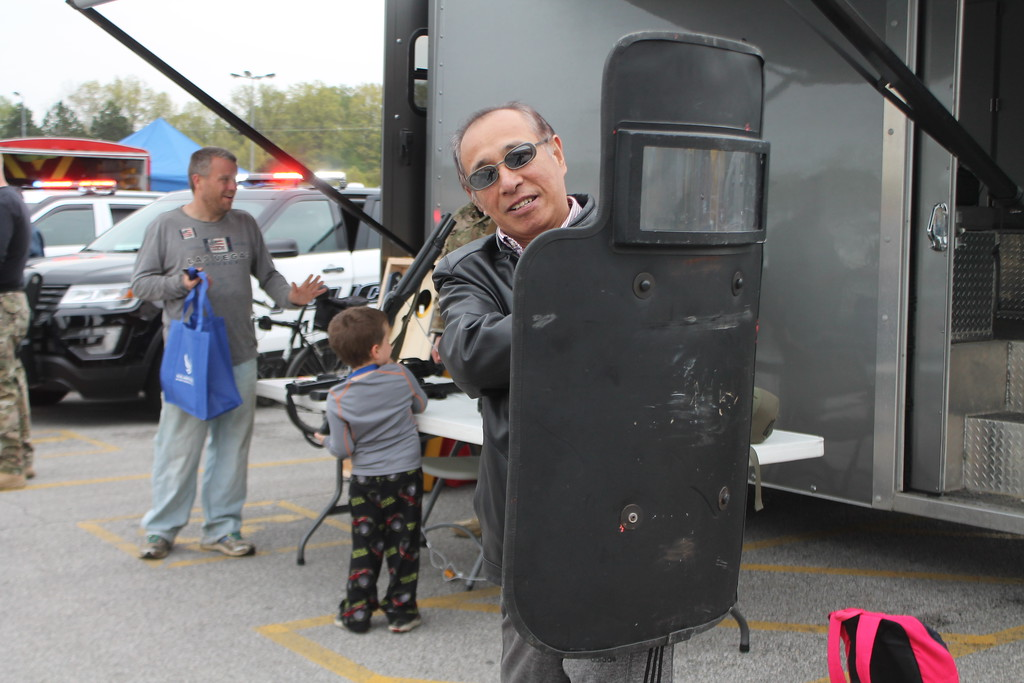 . Kristi Garabrandt � The News-Herald <br> Fu Men of China tries checks out a shield used by Mentor SWAT Department during the 36th Annual Heroes Day held at Great Lakes Mall, May 12, 2018.