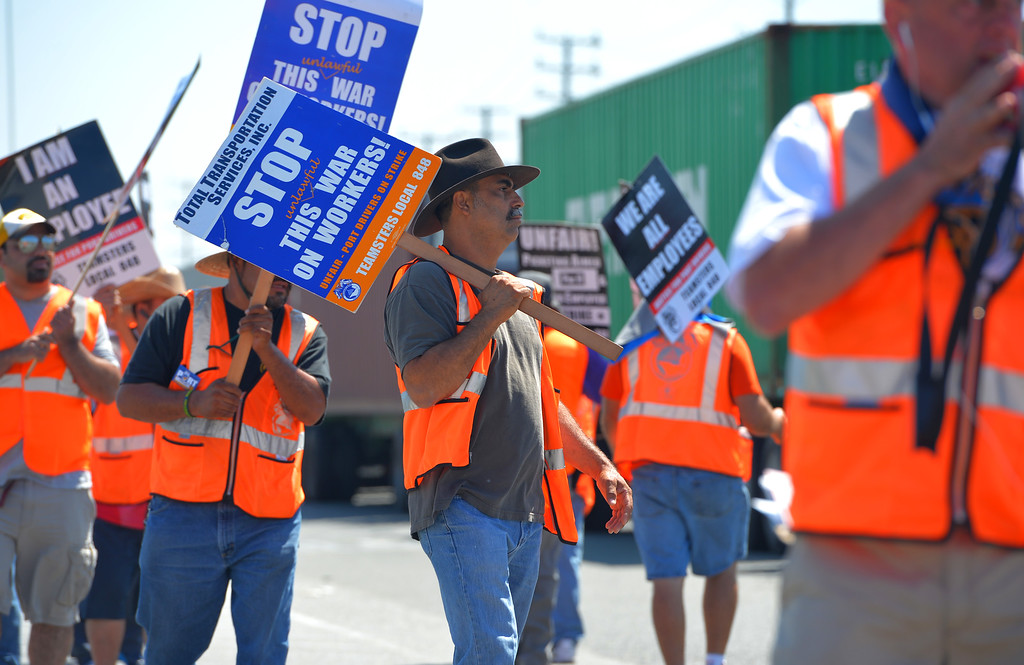 . Striking Teamsters block trucks trying to leave the Evergreen terminal on Terminal Island, CA on Wednesday, July 9, 2014. Truckers are in their third day of their port strike.  (Photo by Scott Varley, Daily Breeze)