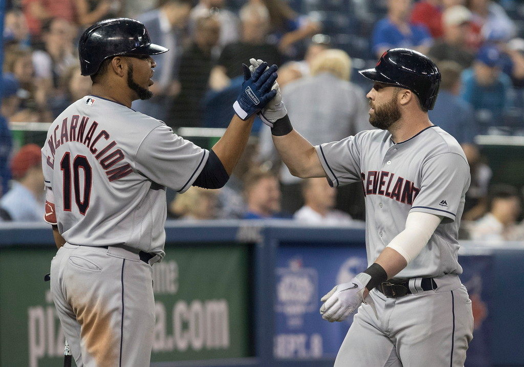 . Cleveland Indians\' Jason Kipnis, right, celebrates his three-run home run against the Toronto Blue Jays with Edwin Incarnation during the ninth inning of a baseball game Thursday, Sept. 6, 2018, in Toronto. (Fred Thornhill/The Canadian Press via AP)