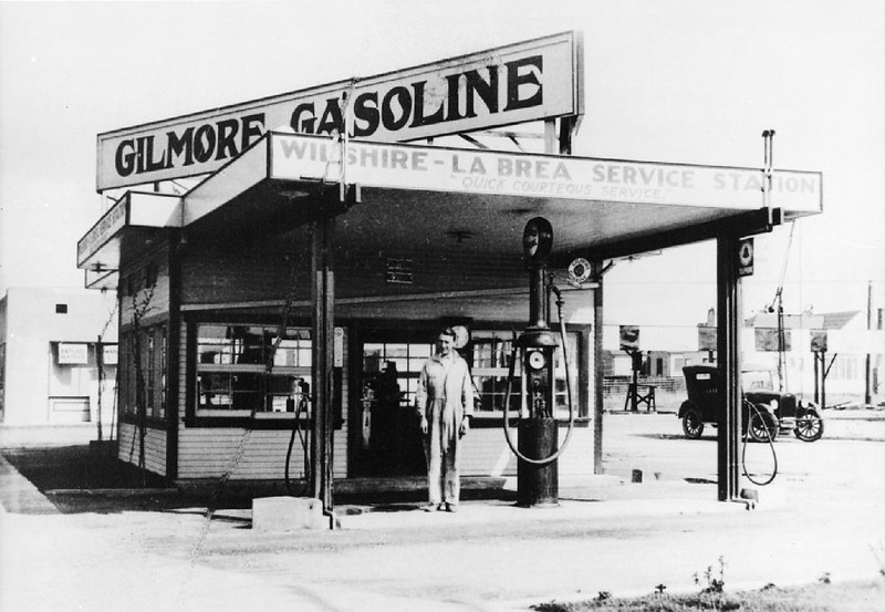 Exterior view of the Gilmore Gasoline station, located at the intersection of Wilshire and La Brea, ca.1920