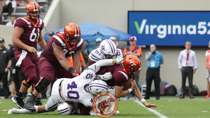 Virginia Tech QB Ryan Willis gets sacked by a pair of Paladins in the first quarter. (Mark Umansky/TheKeyPlay.com)