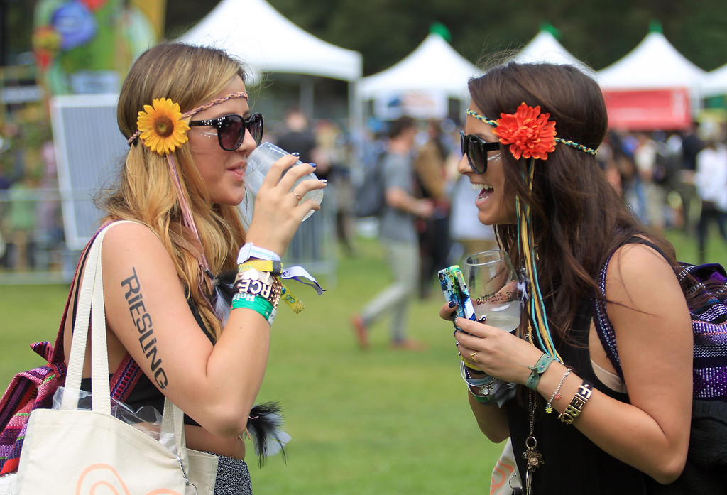 . Z\'Dra Jaye, left, and Michelle Foley, right, of Los Angeles, hang out near Winelands during the 6th annual Outside Lands Music and Arts Festival in Golden Gate Park in San Francisco, Calif., on Friday, Aug. 9, 2013.  (Jane Tyska/Bay Area News Group)