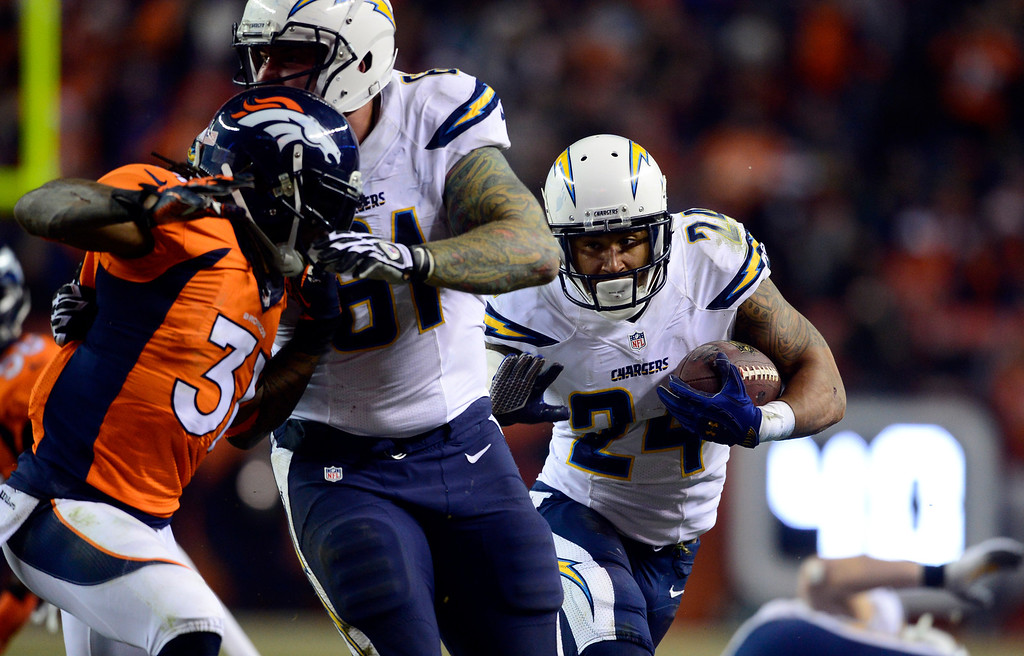 . DENVER, CO - DECEMBER 12: San Diego Chargers running back Ryan Mathews (24) runs the ball in for a touchdown during the second half.  The Denver Broncos vs. the San Diego Chargers at Sports Authority Field at Mile High in Denver on December 12, 2013. (Photo by AAron Ontiveroz/The Denver Post)