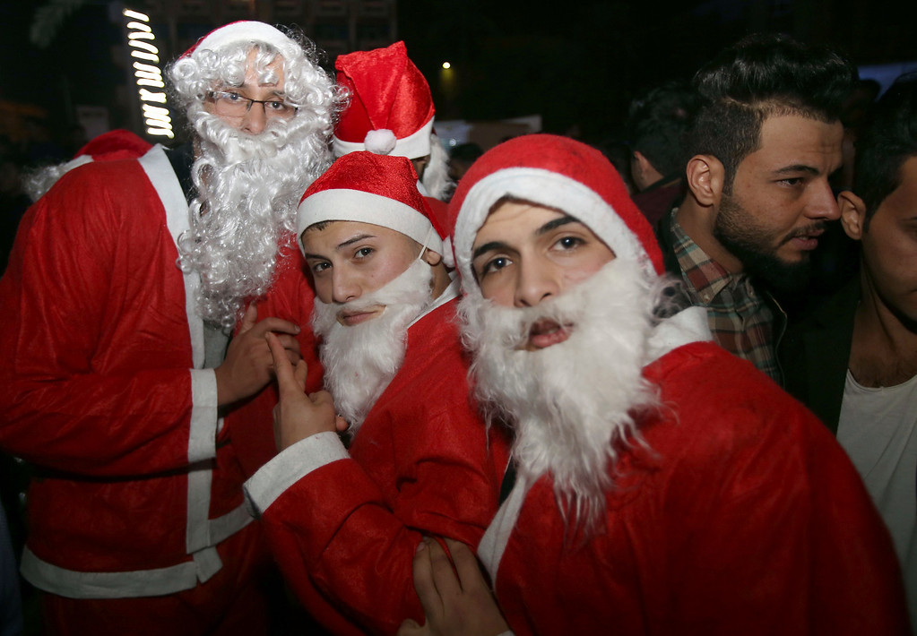 . In this Saturday, Dec. 31, 2016 photo, men dressed as Santa Claus celebrate New Year\'s Eve, in Baghdad, Iraq. (AP Photo/ Karim Kadim)