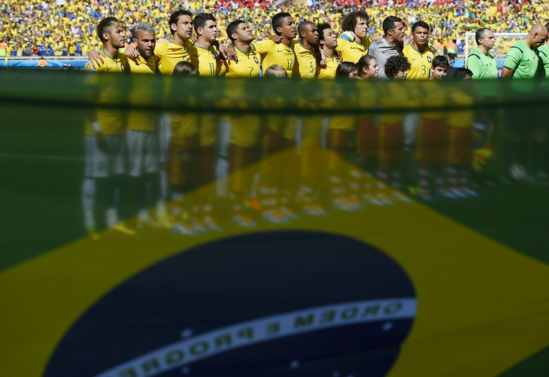 . Brazil\'s players listen to their national anthem before the start of the round of 16 football match between Brazil and Chile at The Mineirao Stadium in Belo Horizonte during the 2014 FIFA World Cup on June 28, 2014.  (FABRICE COFFRINI/AFP/Getty Images)