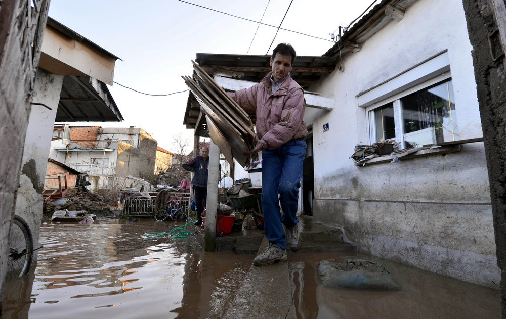 Description of . A man removes furniture from a flooded house in Sveti Nikole, in central Macedonia, on Tuesday, Feb. 26, 2013. Extensive flooding has hit Macedonia after three days of heavy rain, leaving one man dead, bridges wiped out and homes and fields inundated Tuesday. Police said a 51-year-old man drowned in the northern town of Kumanovo after being swept away Monday while trying to cross a river. His body was discovered Tuesday by rescue crews in the mountainous Balkan nation. (AP Photo/Boris Grdanoski)