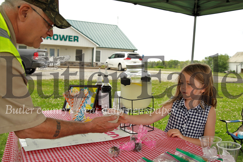 Gianna Shwallon serves up some fresh lemonade at her lemonade stand. Seb Foltz/Butler Eagle