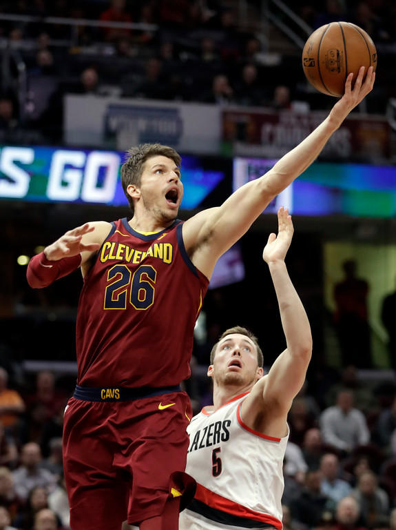 . Cleveland Cavaliers\' Kyle Korver (26) drives to the basket against Portland Trail Blazers\' Pat Connaughton (5) in the second half of an NBA basketball game, Tuesday, Jan. 2, 2018, in Cleveland. The Cavaliers won 127-110. (AP Photo/Tony Dejak)
