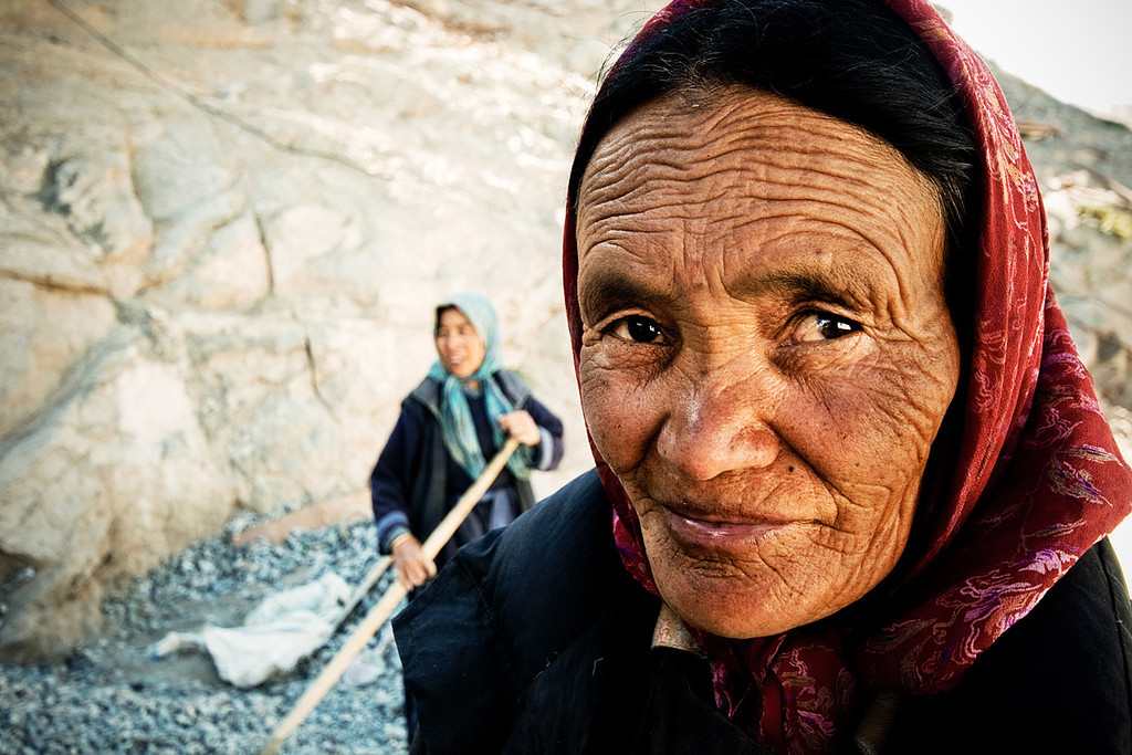 """""""She calls out to the man on the street  ...<br />      ........  You can tell from the lines on her face .. """"<br /> <br /> Women at Thiksey Monastery"""