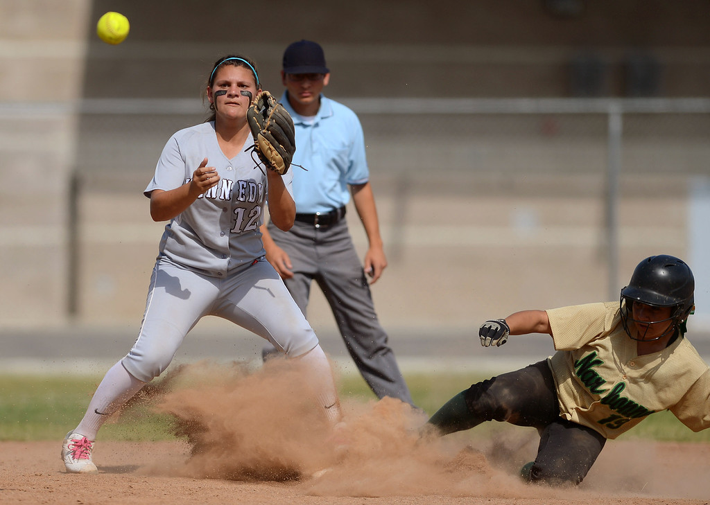 . Kennedy\'s Melissa Boundy makes a catch as Lovey Corniel of Narbonne is safe at second during the CIF City Section Div. I softball semifinal in Granada Hills, Ca May 21, 2013.(Andy Holzman/Staff Photographer)