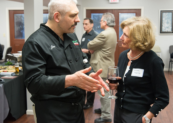 04/09/19 Wesley Bunnell | Staff New Britain Memorial - Sagariino Funeral Home hosted an after hours event on Tuesday evening for the New Britain Chamber of Commerce members. Owner of Angelo's Market Joseph Tropea speaks with Karen Sagarino during the event.