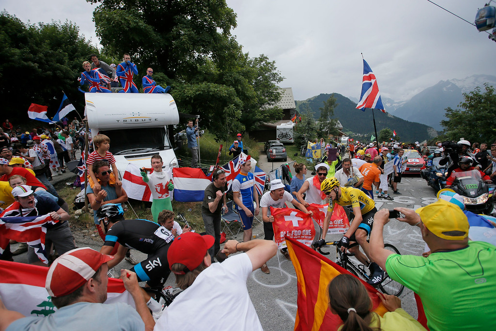 . Richie Porte of Australia, bottom left, and Christopher Froome of Britain, wearing the overall leader\'s yellow jersey, climb towards Alpe-d\'Huez pass during the eighteenth stage of the Tour de France cycling race over 172.5 kilometers (107.8 miles) with start in Gap and finish in Alpe-d\'Huez, France, Thursday July 18, 2013. (AP Photo/Laurent Rebours)
