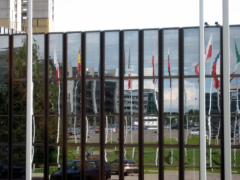 Flags of Europe reflected in the buildings of the European Centre