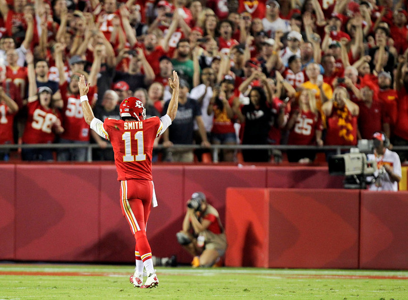 . Kansas City Chiefs quarterback Alex Smith celebrates after a 2-yard touchdown run by Chiefs running back Jamaal Charles during the first quarter of an NFL football game against the New England Patriots, Monday, Sept. 29, 2014, in Kansas City, Mo. (AP Photo/Ed Zurga)