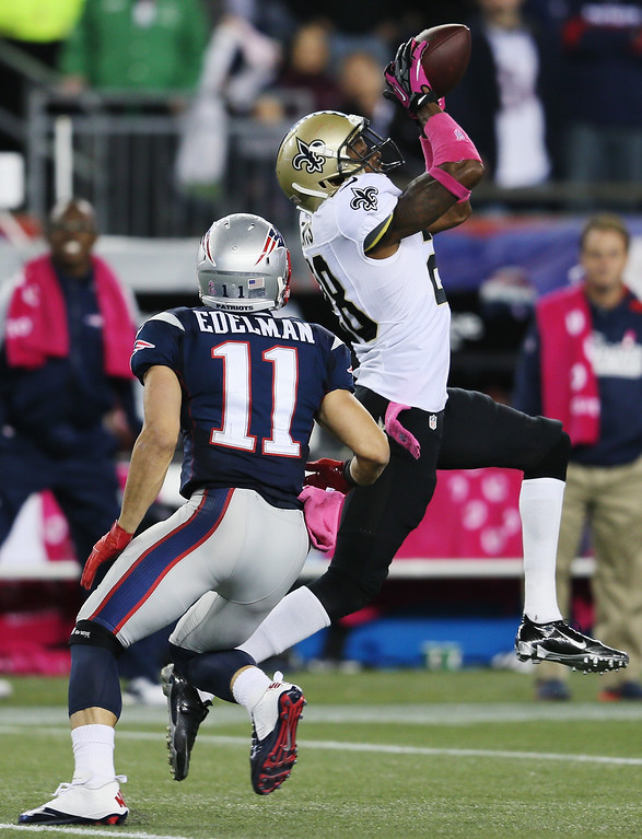 . Cornerback Keenan Lewis #28 of the New Orleans Saints intercepts a pass intended for wide receiver Julian Edelman #11 of the New England Patriots during the fourth quarter of the Patriots 30-27 game at Gillette Stadium on October 13, 2013 in Foxboro, Massachusetts.  (Photo by Rob Carr/Getty Images)