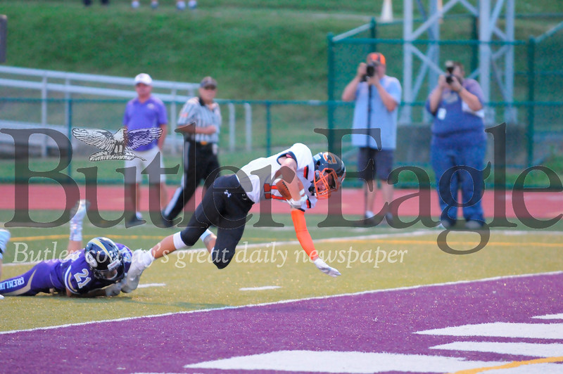 Clarion #17 Ethan Burford dives into the end zone as Karns City #21 Hunter Rowe tries to stop him during a game at Karns City Stadium on Friday September 7, 2018. (Jason Swanson photo)