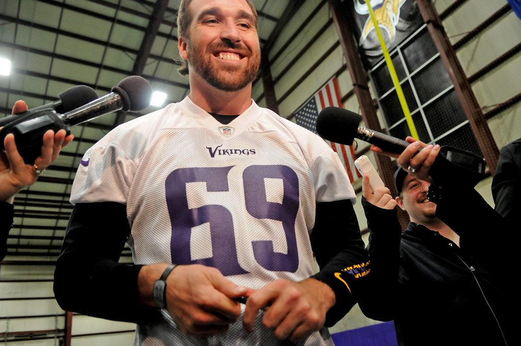 . Vikings defensive end Jared Allen chuckles with members of the media following organized team activities at Winter Park in Eden Prairie on Wednesday, June 5, 2013. (Pioneer Press: Jean Pieri)