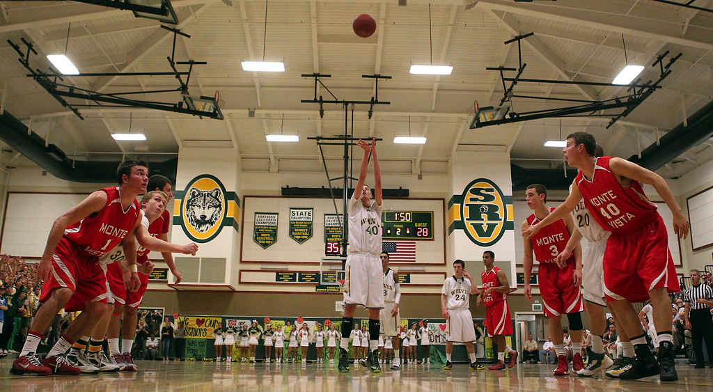 . San Ramon Valley\'s David Gunn (40) shoots a free throw in the first half of their varsity boys basketball game against Monte Vista in Danville, Calif., on Friday, Feb. 15, 2013. (Anda Chu/Staff)