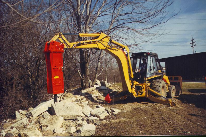 NPK E208 hydraulic hammer on Cat backhoe.jpg