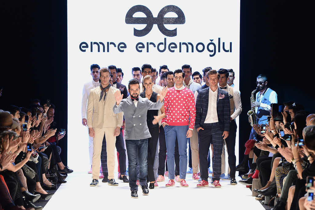 . Fashion designer Emre Erdemoglu (C) and models walk the runway at the Emre Erdemoglu show during Mercedes-Benz Fashion Week Istanbul s/s 2014 presented by American Express on October 8, 2013 in Istanbul, Turkey.  (Photo by Ian Gavan/Getty Images for IMG)