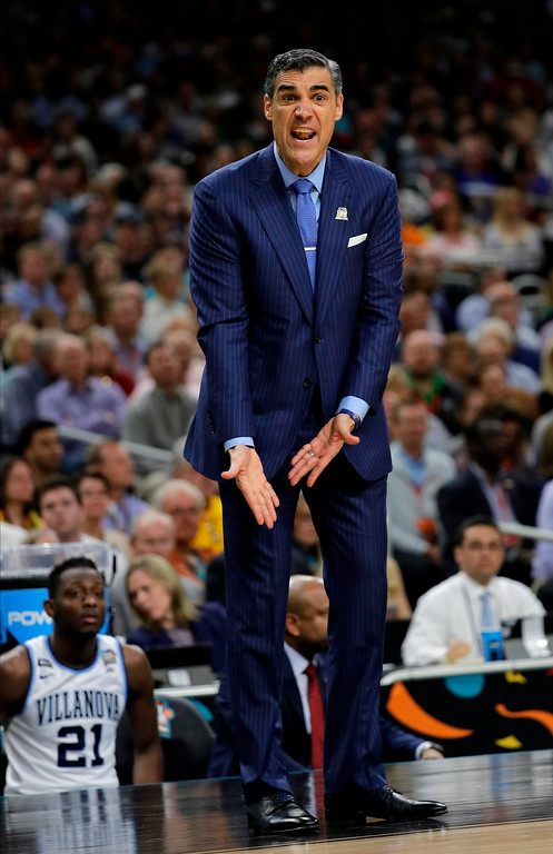 . Villanova head coach Jay Wright questions a call during the first half against Michigan in the championship game of the Final Four NCAA college basketball tournament, Monday, April 2, 2018, in San Antonio. (AP Photo/David J. Phillip)
