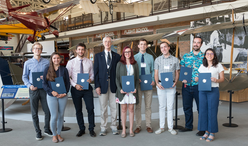 "From left: Charles Bowers, Kayla Bigham, Jeremy Auclair, John Mather, Sierra Casten, Joe Taylor, Ryan Morris, Seamus Anderson, Stela Ishitani Silva [Not pictured: Justin Long] -- An award luncheon, ""Dr. John Mather Nobel Scholars Program Award"", as part of the National Space Grant Foundation. College Park Aviation Museum, College Park, MD, August 2, 2019."