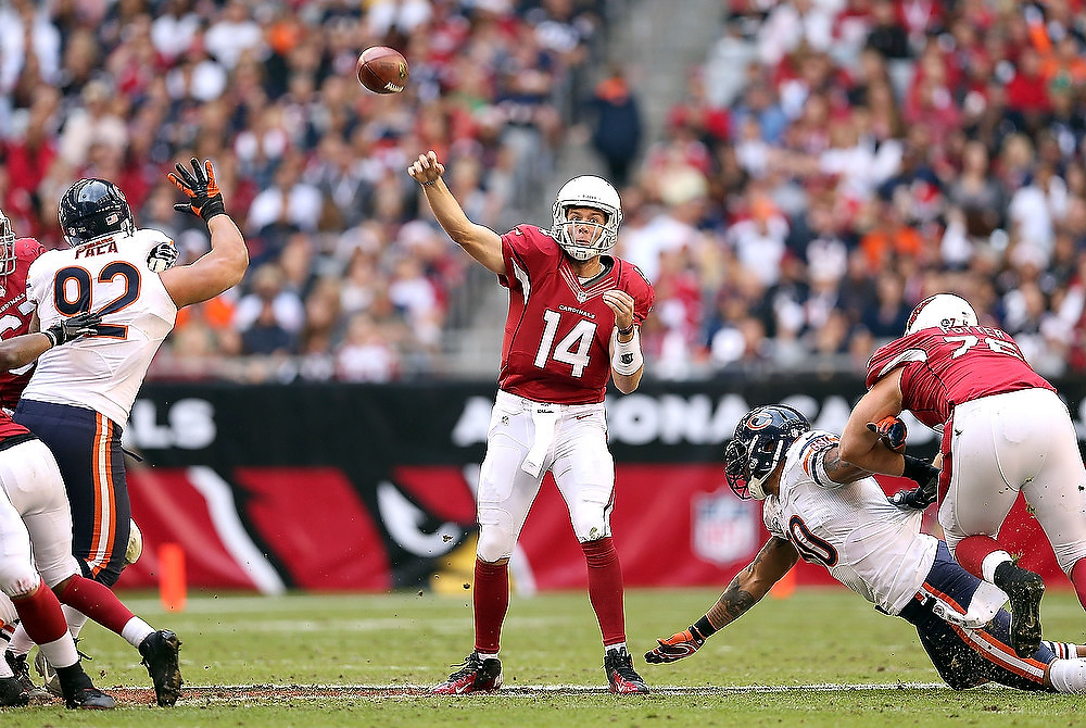 . Quarterback Ryan Lindley #14 of the Arizona Cardinals throws a pass during the NFL game against the Chicago Bears at the University of Phoenix Stadium on December 23, 2012 in Glendale, Arizona.  (Photo by Christian Petersen/Getty Images)
