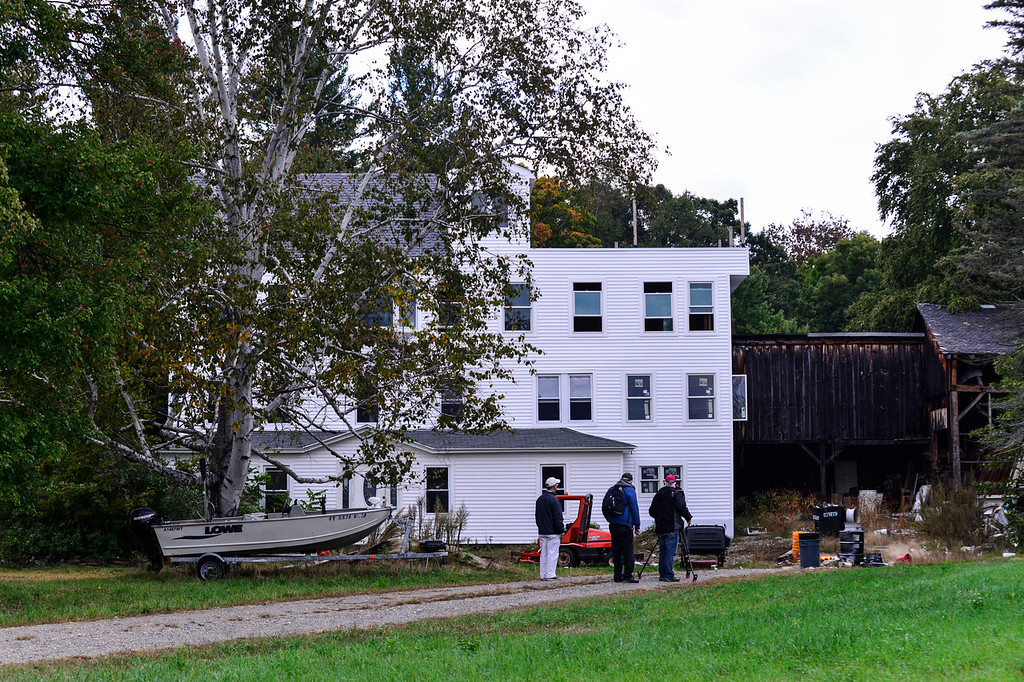 . Reporters gather outside Nathan Carman\'s, survived eight days out at sea, house in Vernon. Vt., on Wednesday, Sept. 28, 2016. Kristopher Radder, Brattleboro Reformer staff via AP.