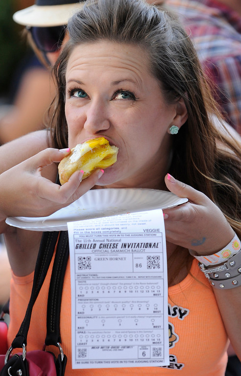 . Katelynn Murray takes a bite of a cheese sanwich she was asked to judge. The 11th Annual Grilled Cheese Invitational was held Saturday at the Los Angeles Center Studios, 1201 W. 5th Street, in downtown. Cheese lovers came together to sample grilled cheese sandwiches in a variety of incarnations. Los Angeles, CA 4/20/2013(John McCoy/Staff Photographer
