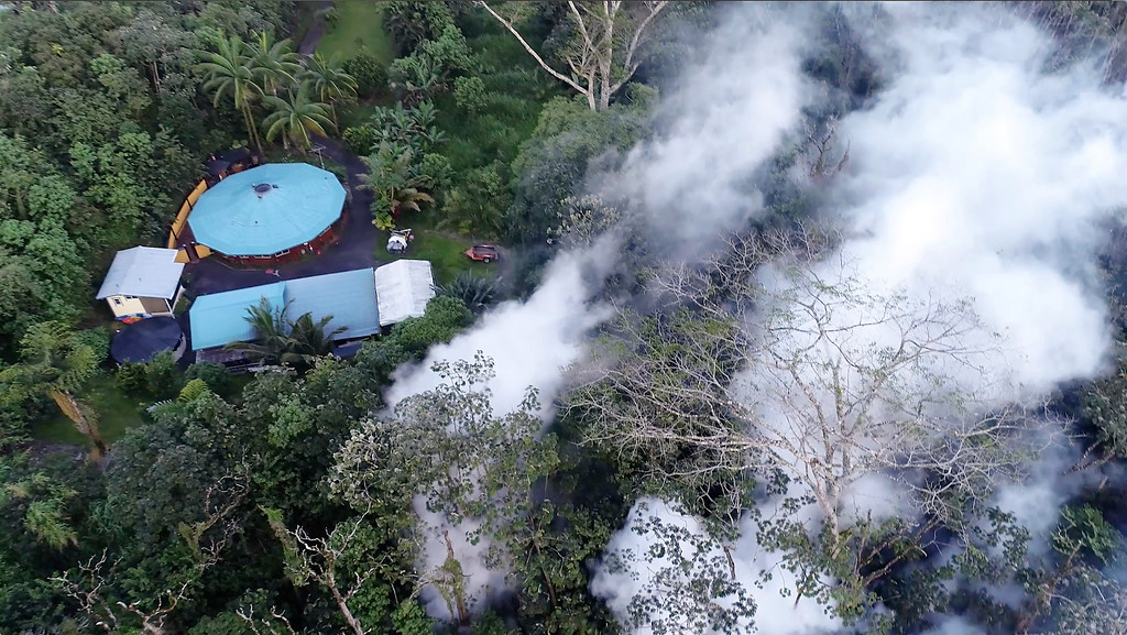 . In this still frame taken from video, lava flows toward a home in the Puna District as a result of the eruption from Kilauea Volcano on Hawaii\'s Big Island, Friday, May 4, 2018. The eruption sent molten lava through forests and bubbling up from paved streets and forced the evacuation of about 1,500 people who were still out of their homes Friday after Thursday\'s eruption. (Byron Matthews via AP)