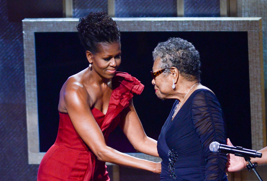 . Michelle Obama and Maya Angelou speak during the BET Honors 2012 at the Warner Theatre on January 14, 2012 in Washington, DC. (Photo by Kris Connor/Getty Images)