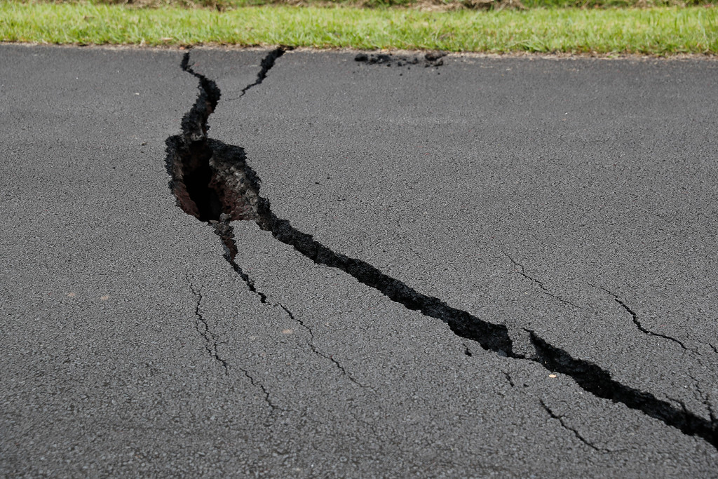 . Large cracks from an earthquake are seen in a road in the Leilani Estates subdivision, Saturday, May 5, 2018, in Pahoa, Hawaii. Hundreds of people on the Big Island of Hawaii are hunkering down for what could be weeks or months of upheaval as the dangers from an erupting Kilauea volcano grow. (AP Photo/Marco Garcia)