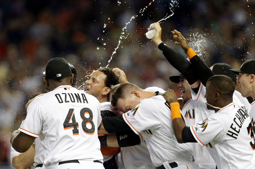 . Miami Marlins\' Henderson Alvarez, second from left, celebrates with teammates after pitching a no-hitter against the Detroit Tigers in an interleague baseball game on Sunday, Sept. 29, 2013, in Miami. The Marlins won 1-0. (AP Photo/Alan Diaz)