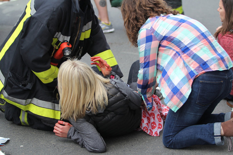 . An injured woman is attended to at the scene of an explosion at the Boston Marathon in Boston, Massachusetts, April 15, 2013. Two explosions struck the marathon as runners crossed the finish line on Monday, witnesses said, injuring an unknown number of people on what is ordinarily a festive day in the city. REUTERS/Daily Free Press/Kenshin Okubo/Boston University/Handout