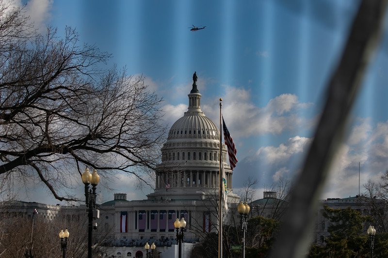 A police helicopter patrols over the U.S. Capitol shortly before the start of the inauguration