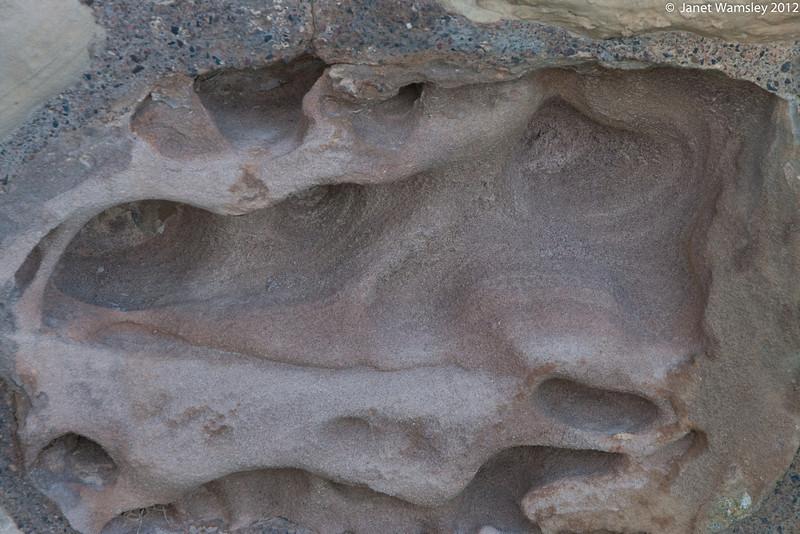 wind wears down sandstone on church wall