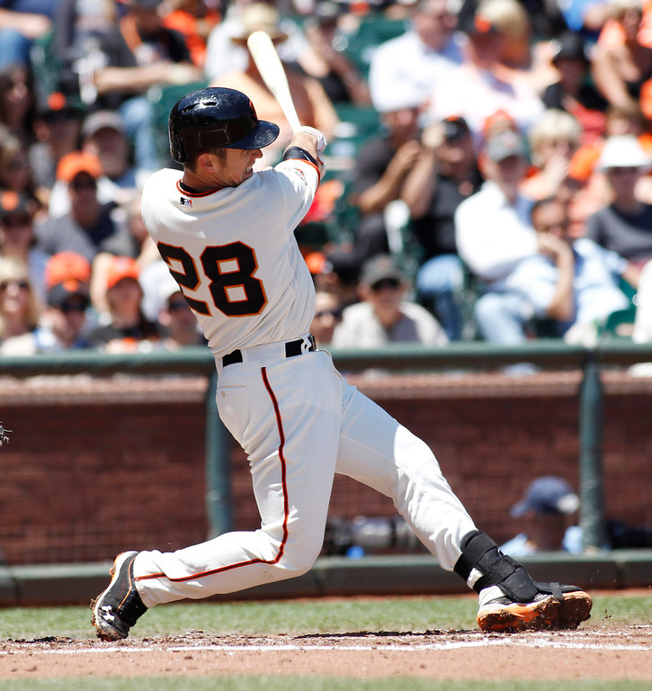 . San Francisco Giants\' Buster Posey hits a home run against the Colorado Rockies during the second inning of a baseball game on Sunday, May 26, 2013, in San Francisco. (AP Photo/George Nikitin)