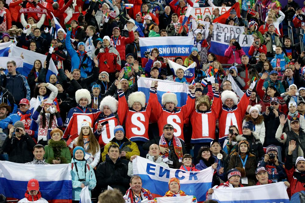 . Fans cheer during the women\'s biathlon 15k individual race, at the 2014 Winter Olympics, Friday, Feb. 14, 2014, in Krasnaya Polyana, Russia. (AP Photo/Lee Jin-man)