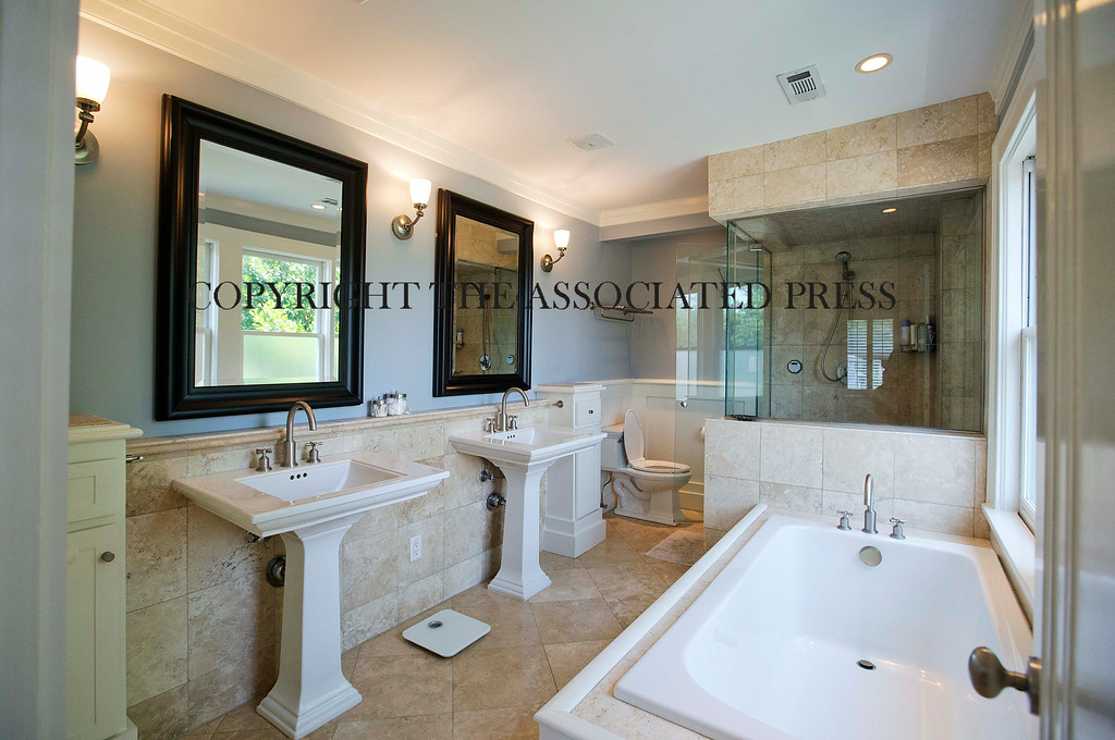 . A pair of matching sinks highlight the master bathroom of this three bedroom house listed for sale at $1,095,000, Wednesday, July 30, 2014, in the Sherwood Forest neighborhood of Atlanta. The 2,551-square-foot house has two and a half bathrooms and features an in-ground pool and garage. (AP Photo/David Goldman)