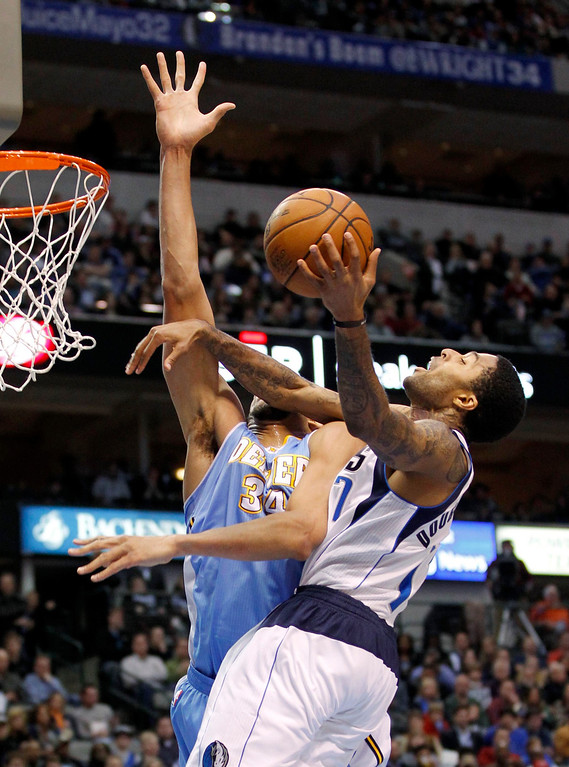 . Dallas Mavericks guard Chris Douglas-Roberts (R) shoots against Denver Nuggets center JaVale McGee during the first half of their NBA basketball game in Dallas, Texas, December 28, 2012.  REUTERS/Mike Stone