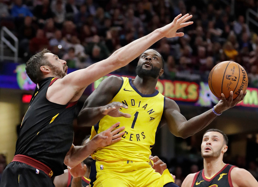 . Indiana Pacers\' Lance Stephenson (1) drives to the basket against Cleveland Cavaliers\' Kevin Love (0) during the second half of Game 2 of an NBA basketball first-round playoff series, Wednesday, April 18, 2018, in Cleveland. The Cavaliers won 100-97. (AP Photo/Tony Dejak)