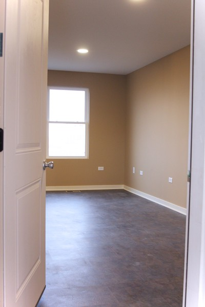 View from garage into side room off of kitchen