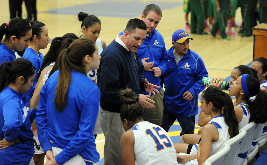 . Bishop Amat head coach Richard Wiard talks to his team during a time-out in the second half of a CIF State Southern California Regional semifinal basketball game against Long Beach Poly at Bishop Amat High School on Tuesday, March 12, 2013 in La Puente, Calif. Long Beach Poly won 52-34.  (Keith Birmingham Pasadena Star-News)