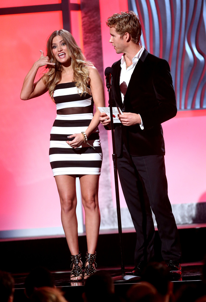 . Presenters Justine Ezarik (iJustine) and Ryan Kwanten speak onstage at the 3rd Annual Streamy Awards at Hollywood Palladium on February 17, 2013 in Hollywood, California.  (Photo by Frederick M. Brown/Getty Images)