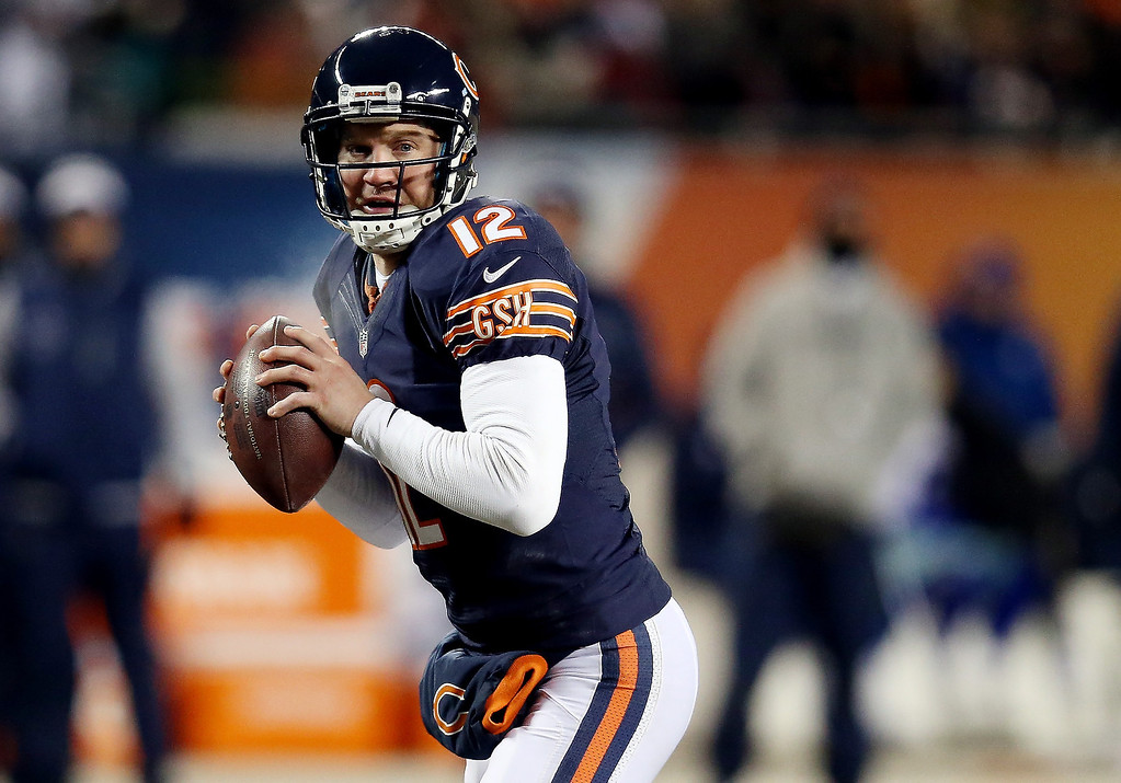 . Quarterback Josh McCown #12 of the Chicago Bears looks to pass against the Dallas Cowboys during a game at Soldier Field on December 9, 2013 in Chicago, Illinois.  (Photo by Jonathan Daniel/Getty Images)