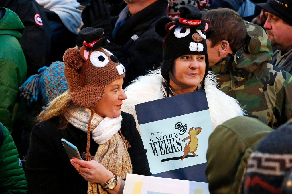 . Members of the crowd at Gobbler\'s Knob for the 131st celebration of Groundhog Day, hold a sign indicating six more weeks of winter, that was forecast by Punxsutawney Phil, the weather prognosticating groundhog, in Punxsutawney, Pa. Thursday, Feb. 2, 2017. Phil\'s handlers said that the groundhog has forecast six more weeks of winter weather. (AP Photo/Gene J. Puskar)